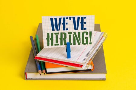 Writing note showing We Are Hiring. Business concept for recently you employ someone or pay someone to do particular job Book pencil rectangle shaped reminder notebook clothespins