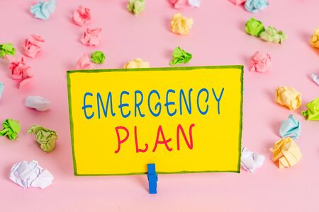 Word writing text Emergency Plan. Business photo showcasing procedures for handling sudden or unexpected situations Colored crumpled papers empty reminder pink floor background clothespin