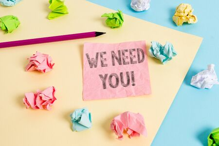Conceptual hand writing showing We Need You. Concept meaning asking someone to work together for certain job or target Colored crumpled papers empty reminder blue yellow clothespin
