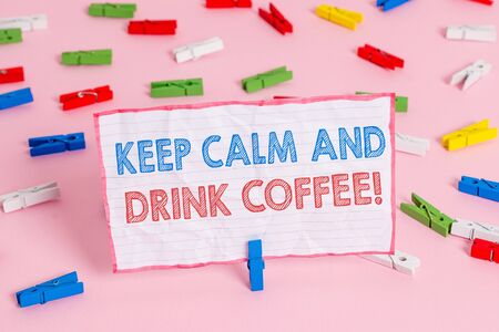 Text sign showing Keep Calm And Drink Coffee. Business photo text encourage demonstrating to enjoy caffeine drink and relax Colored clothespin papers empty reminder pink floor background office pin