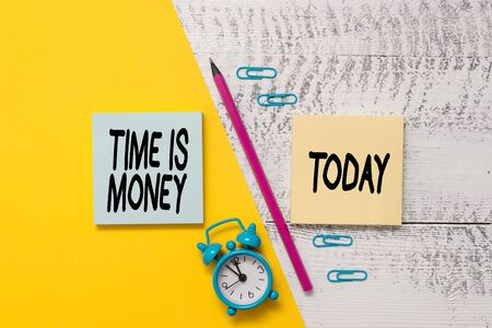 Word writing text Time Is Money. Business photo showcasing time is a valuable resource Do things as quickly as possible Notepads marker pen colored paper sheet alarm clock wooden background