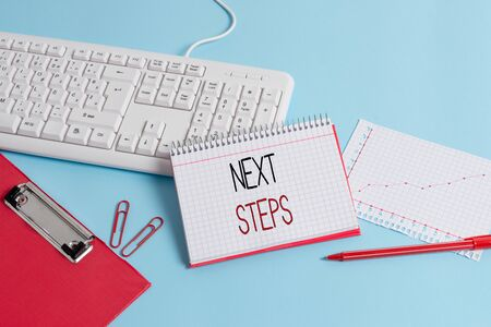 Writing note showing Next Steps. Business concept for something you do or plan after you ve finished something else Paper blue keyboard office study notebook chart numbers memo