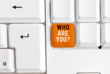 Writing note showing Who Are You Question. Business concept for asking about someone identity or demonstratingal information White pc keyboard with note paper above the white background