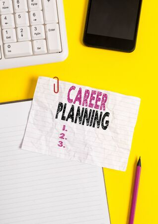 Text sign showing Career Planning. Business photo text Strategically plan your career goals and work success Crumpled white paper on table with paper clips clock mobile and pc keyboard Stock fotó