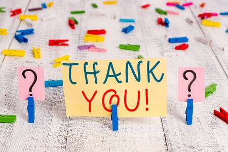 Writing note showing Thank You. Business concept for polite expression used when acknowledging gift service compliment Crumbling sheet with paper clips placed on the wooden table