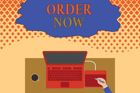 Writing note showing Order Now. Business concept for the activity of asking for goods or services from a company Upper view laptop wooden desk worker drawing tablet coffee cup office Stock Photo