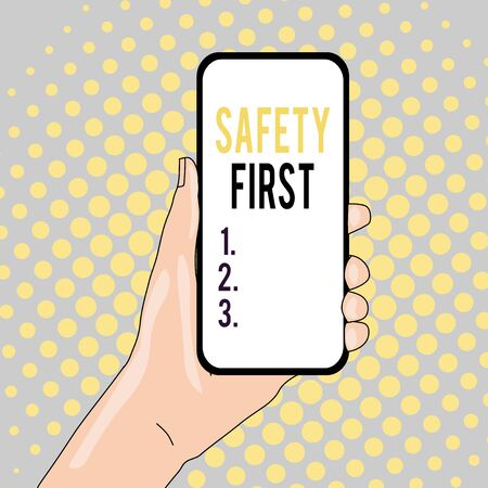 Conceptual hand writing showing Safety First. Concept meaning used to say that the most important thing is to be safe Closeup of Smartphone Device Held in Hand and Text Space