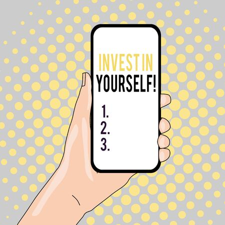 Conceptual hand writing showing Invest In Yourself. Concept meaning nvesting in a coach or a training to learn new things Closeup of Smartphone Device Held in Hand and Text Space Zdjęcie Seryjne - 128881988