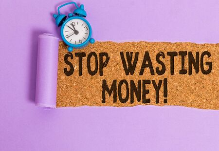 Writing note showing Stop Wasting Money. Business concept for advicing demonstrating or group to start saving and use it wisely