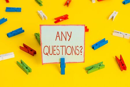 Conceptual hand writing showing Any Questions Question. Concept meaning you say write order to ask demonstrating about something Colored clothespin papers empty reminder yellow floor office