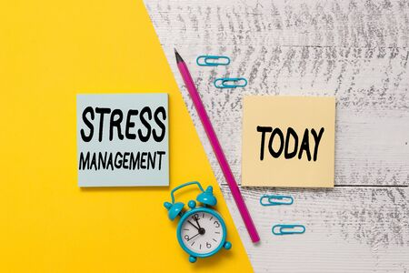 Word writing text Stress Management. Business photo showcasing method of limiting stress and its effects by learning ways Notepads marker pen colored paper sheet alarm clock wooden background