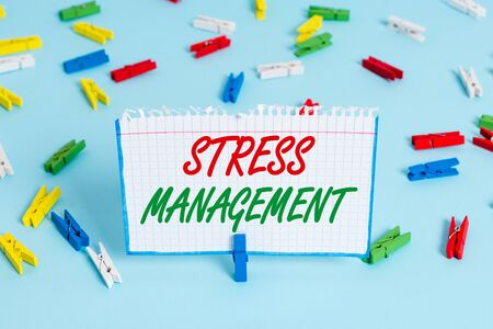 Text sign showing Stress Management. Business photo showcasing method of limiting stress and its effects by learning ways Colored clothespin papers empty reminder blue floor background office pin
