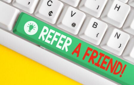 Text sign showing Refer A Friend. Business photo text direct someone to another or send him something like gift White pc keyboard with empty note paper above white background key copy space