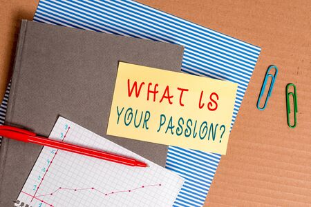 Handwriting text What Is Your Passion Question. Conceptual photo asking about his strong and barely controllable emotion Striped paperboard notebook cardboard office study supplies chart paper