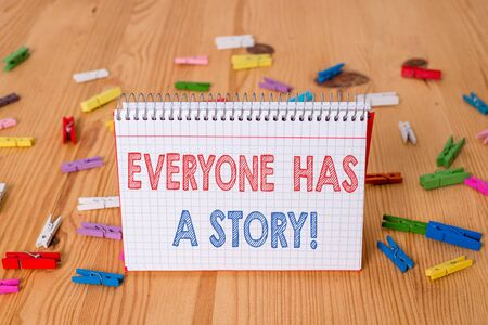 Handwriting text writing Everyone Has A Story. Conceptual photo account of past events in someones life or career Colored clothespin papers empty reminder wooden floor background office