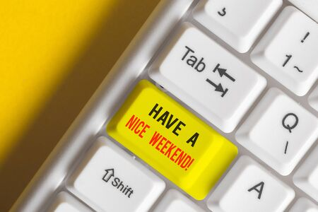 Word writing text Have A Nice Weekend. Business photo showcasing wishing someone that something nice happen holiday White pc keyboard with empty note paper above white background key copy space Archivio Fotografico
