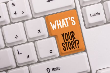 Text sign showing What S Your Story Question. Business photo text asking demonstrating about his past life actions career or events White pc keyboard with empty note paper above white background key copy space