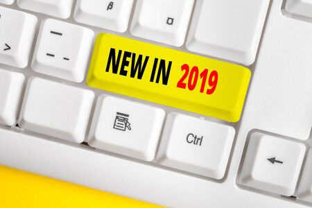 Text sign showing New In 2019. Business photo text what will be expecting or new creation for the year 2019 White pc keyboard with empty note paper above white background key copy space