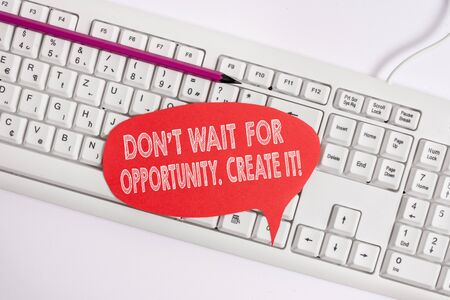 Text sign showing Don T Wait For Opportunity Create It. Business photo text work hard on yourself and begin from this moment Empty copy space red note paper bubble above pc keyboard for text message