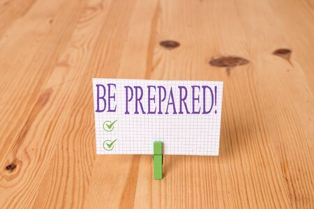 Writing note showing Be Prepared. Business concept for try be always ready to do or deal with something Wooden floor background green clothespin groove slot office