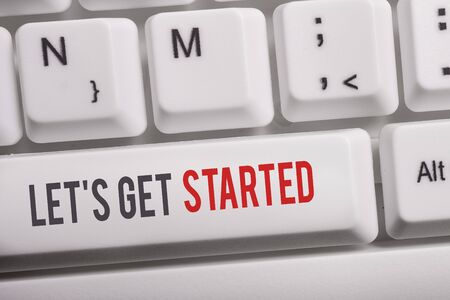 Text sign showing Let S Is Get Started. Business photo text to begin doing or working on something you had started White pc keyboard with empty note paper above white background key copy space