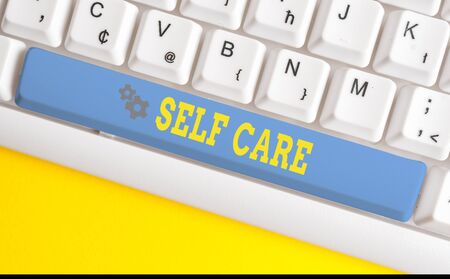 Text sign showing Self Care. Business photo text the practice of taking action to improve one s is own health White pc keyboard with empty note paper above white background key copy space Stock fotó