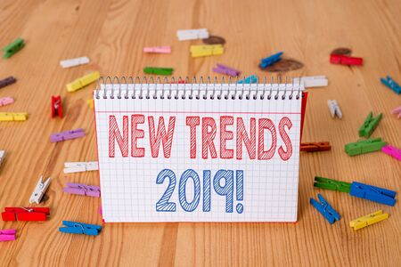 Handwriting text writing New Trends 2019. Conceptual photo general direction in which something is developing Colored clothespin papers empty reminder wooden floor background office
