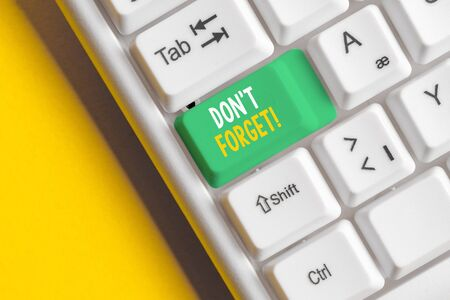 Word writing text Don T Forget. Business photo showcasing used to remind someone about an important fact or detail White pc keyboard with empty note paper above white background key copy space Stock Photo