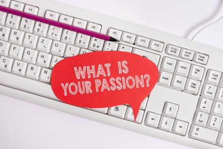 Text sign showing What Is Your Passion Question. Business photo text asking about his strong and barely controllable emotion Empty copy space red note paper bubble above pc keyboard for text message
