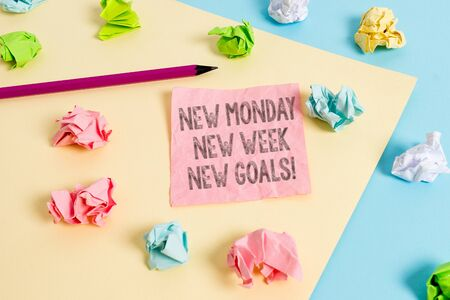 Conceptual hand writing showing New Monday New Week New Goals. Concept meaning goodbye weekend starting fresh goals targets Colored crumpled papers empty reminder blue yellow clothespin Stock fotó