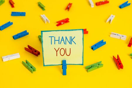 Text sign showing Thank You. Business photo text a polite expression used when acknowledging a gift or service Colored clothespin papers empty reminder yellow floor background office