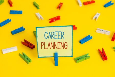 Text sign showing Career Planning. Business photo text Strategically plan your career goals and work success Colored clothespin papers empty reminder yellow floor background office Stock fotó