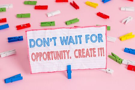 Text sign showing Don T Wait For Opportunity Create It. Business photo text work hard on yourself and begin from this moment Colored clothespin papers empty reminder pink floor background office pin
