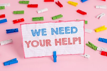 Text sign showing We Need Your Help. Business photo text asking someone to stand with you against difficulty Colored clothespin papers empty reminder pink floor background office pin Archivio Fotografico