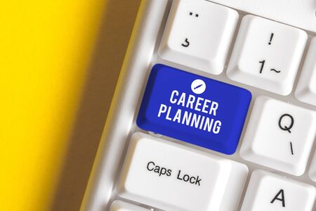 Conceptual hand writing showing Career Planning. Concept meaning Strategically plan your career goals and work success White pc keyboard with note paper above the white background