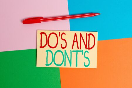 Conceptual hand writing showing Do's And Dont's. Concept meaning Rules or customs concerning some activity or actions Office appliance square desk study supplies paper sticker