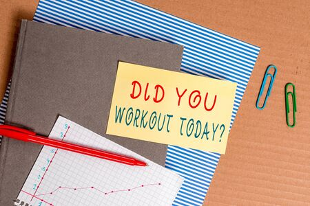 Handwriting text Did You Workout Today. Conceptual photo asking if made session physical exercise Striped paperboard notebook cardboard office study supplies chart paper Archivio Fotografico