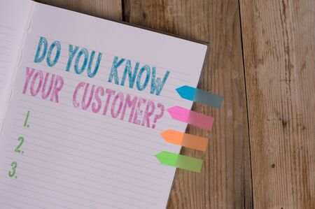 Text sign showing Do You Know Your Customer Question. Business photo text service identify clients with relevant information Striped note book four colored arrow banners reminder wooden background