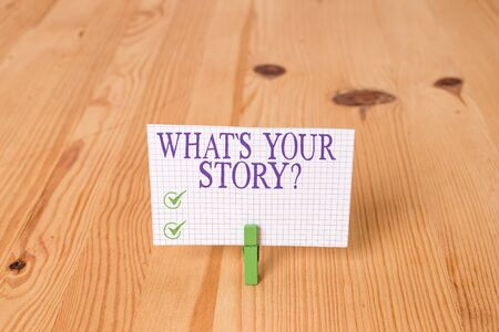 Writing note showing What S Your Story Question. Business concept for asking demonstrating about his past life actions career or events Wooden floor background green clothespin groove slot office 写真素材