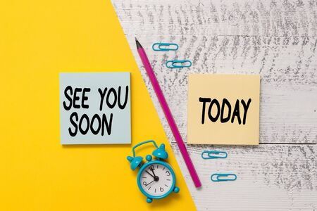 Word writing text See You Soon. Business photo showcasing used for saying goodbye to someone and going to meet again soon Notepads marker pen colored paper sheet alarm clock wooden background