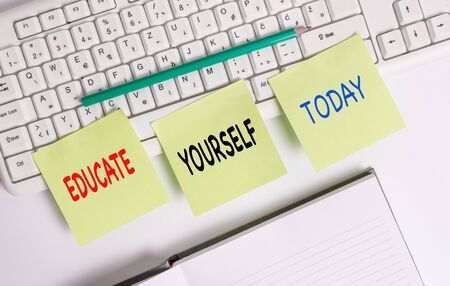 Word writing text Educate Yourself. Business photo showcasing prepare oneself or someone in a particular area or subject Three empty green square papers by the pc keyboard with copy space Stock Photo