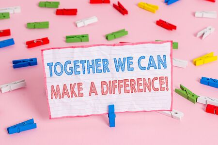Text sign showing Together We Can Make A Difference. Business photo text be very important some way in like team or group Colored clothespin papers empty reminder pink floor background office pin