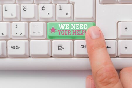 Conceptual hand writing showing We Need Your Help. Concept meaning asking someone to stand with you against difficulty White pc keyboard with note paper above the white background