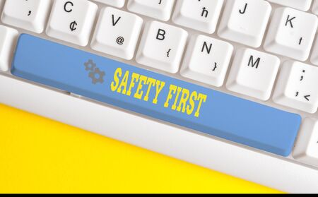Text sign showing Safety First. Business photo text used to say that the most important thing is to be safe White pc keyboard with empty note paper above white background key copy space