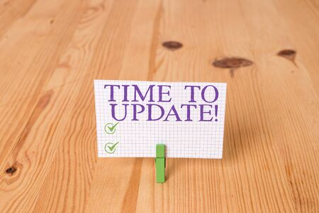Writing note showing Time To Update. Business concept for this is right moment to make something more modern new Wooden floor background green clothespin groove slot office