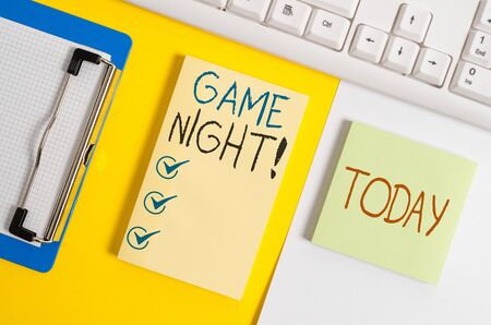 Writing note showing Game Night. Business concept for usually its called on adult play dates like poker with friends Paper with copy space and keyboard above orange background table