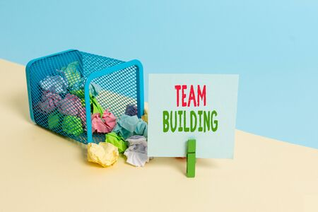Text sign showing Team Building. Business photo showcasing various types of activities used to enhance social relations Trash bin crumpled paper clothespin empty reminder office supplies tipped