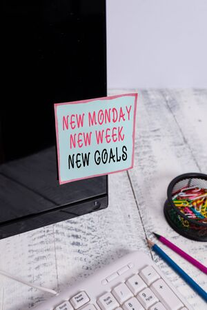 Word writing text New Monday New Week New Goals. Business photo showcasing showcasing next week resolutions To do list Note paper taped to black computer screen near keyboard and stationary