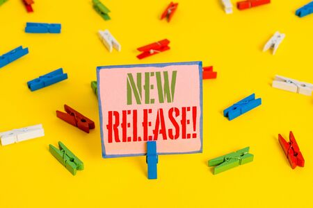 Word writing text New Release. Business photo showcasing announcing something newsworthy recent product Colored clothespin papers empty reminder yellow floor background office Foto de archivo - 129006860