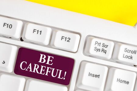 Handwriting text writing Be Careful. Conceptual photo making sure of avoiding potential danger mishap or harm White pc keyboard with empty note paper above white background key copy space